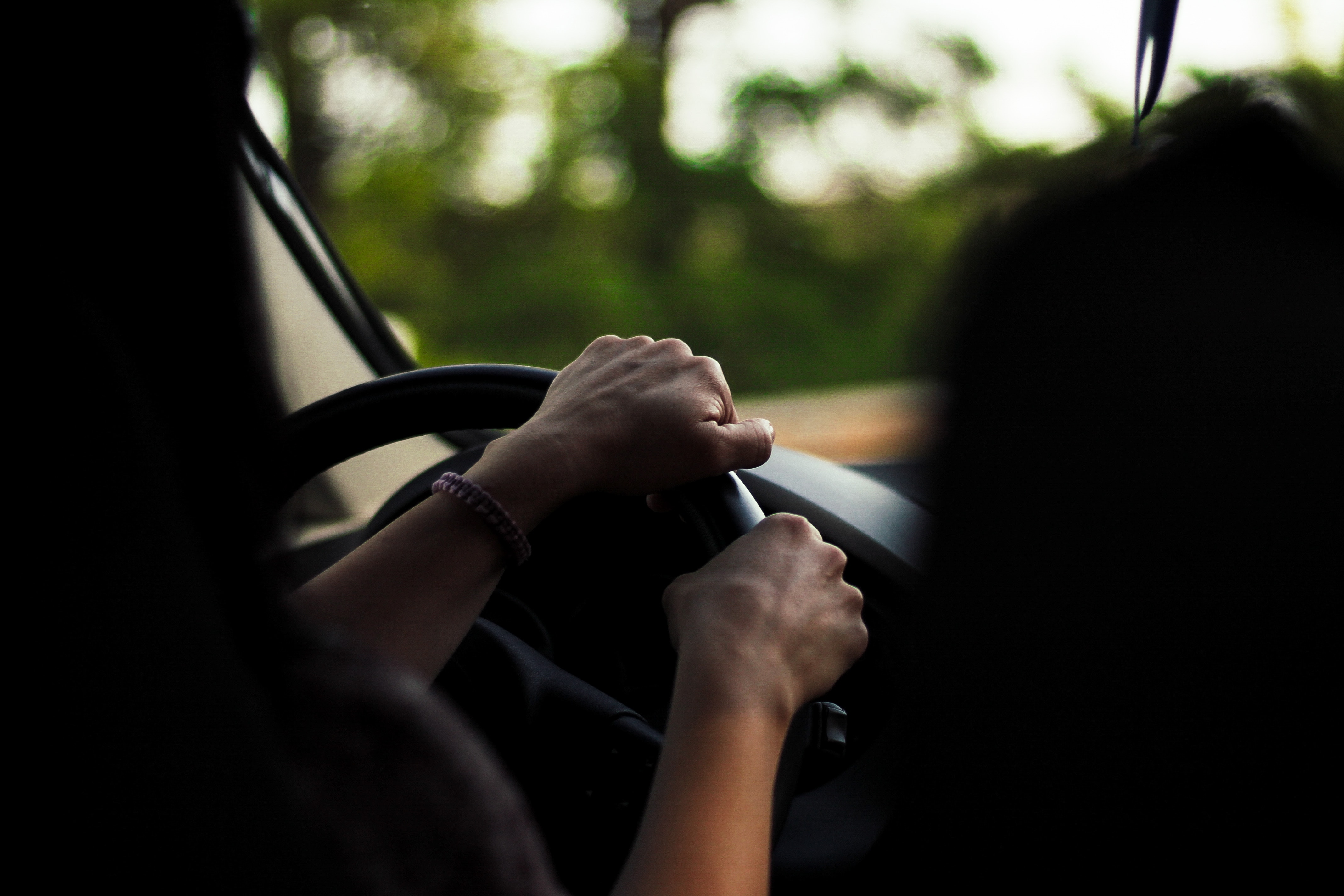 Photo of person driving automatic car