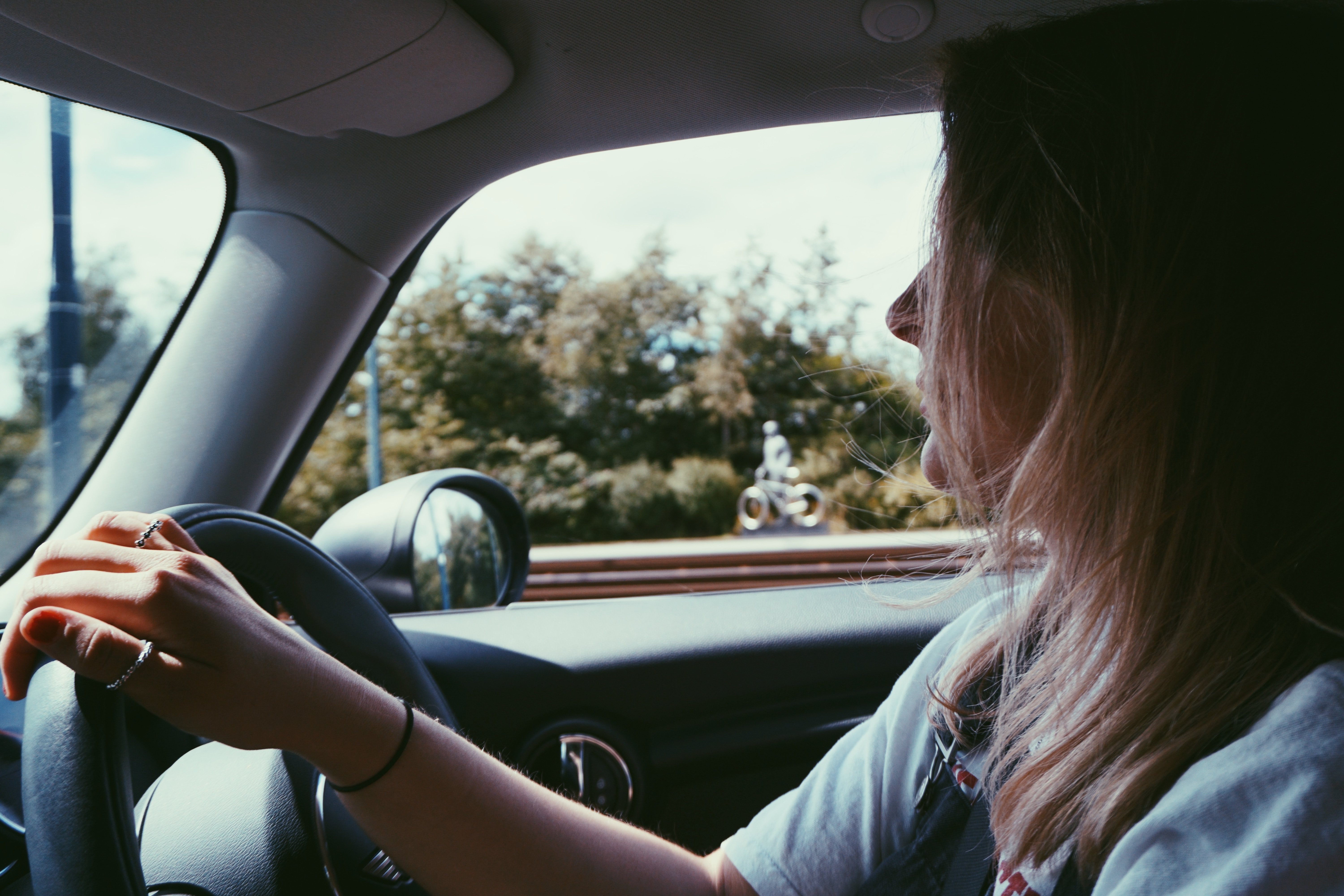 Photo of young woman driving